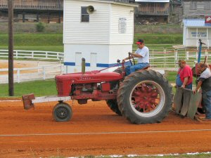 Larry Roberts on his H Farmall
